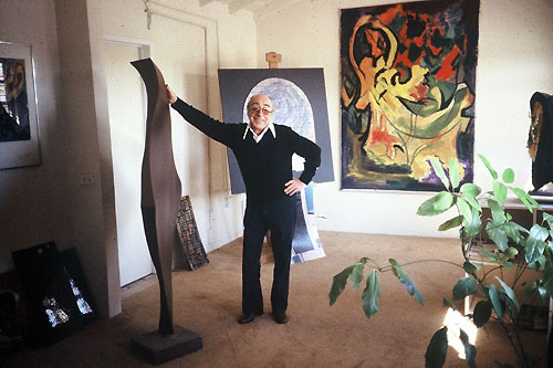 Roger Darricarrere, designer of St. Bernard's stained glass windows, in his studio.